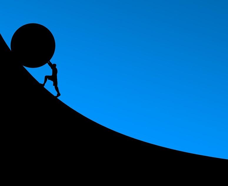 Pushing a ball up hill